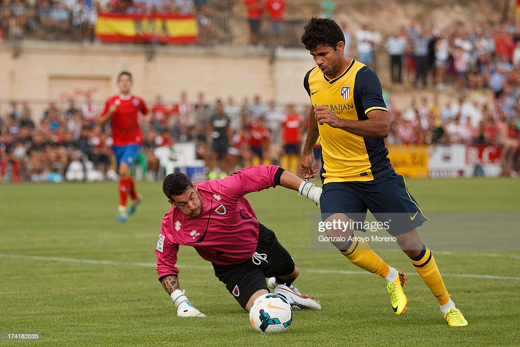 Diego Costa of Atletico de Madrid scores their second goal as he rounds goalkeeper Biel Ribas of Numancia CD during the Jesus Gil y Gil Trophy between Club Atletico de Madrid and Numancia C. D. at Sporting Club Uxama on July 21, 2013 in Burgo de Osma, Soria, Spain.
