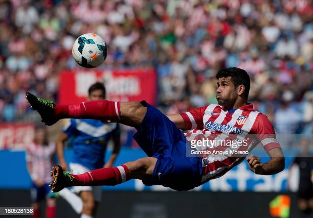 Diego Costa of Atletico de Madrid shoots during the La Liga match between Club Atletico de Madrid and UD Almeria at Vicente Calderon Stadium on...