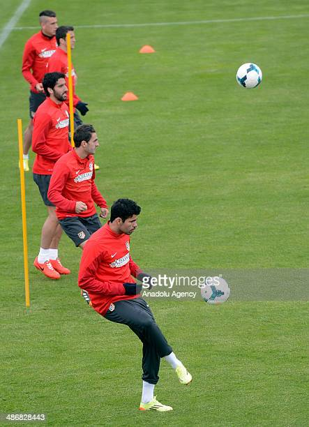 Diego Costa of Atletico Madrid exercises during a training session in Majadahonda near Madrid on April 26 2014 ahead of the Spanish La Liga match...