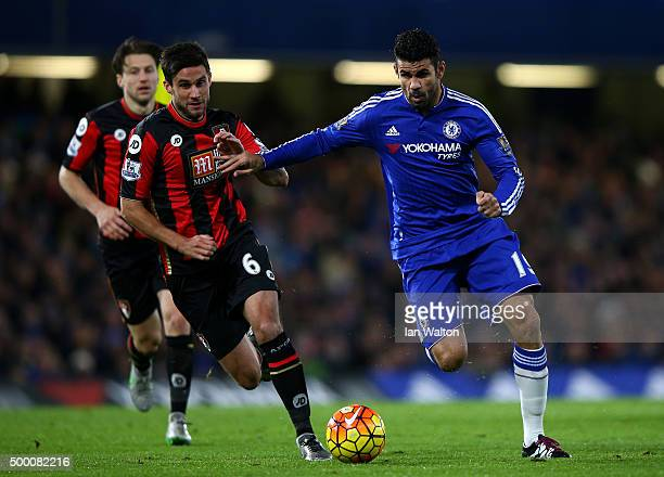 Diego Costa of Chelsea and Andrew Surman of Bournemouth compete for the ball during the Barclays Premier League match between Chelsea and AFC...
