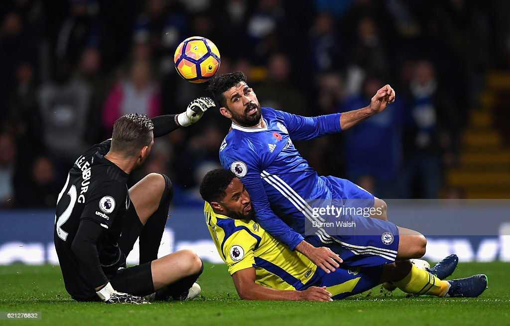 Diego Costa of Chelsea (R) and Ashley Williams of Everton (C) colide during the Premier League match between Chelsea and Everton at Stamford Bridge on November 5, 2016 in London, England.