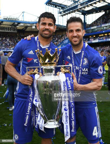Diego Costa of Chelsea and Cesc Fabregas of Chelsea pose with the Preimer League trophy after the Premier League match between Chelsea and Sunderland...