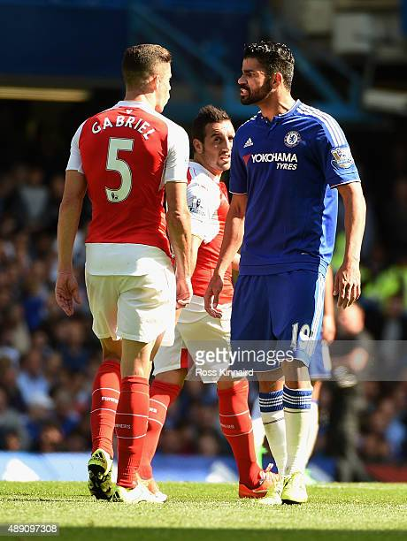 Diego Costa of Chelsea and Gabriel of Arsenal argue during the Barclays Premier League match between Chelsea and Arsenal at Stamford Bridge on...
