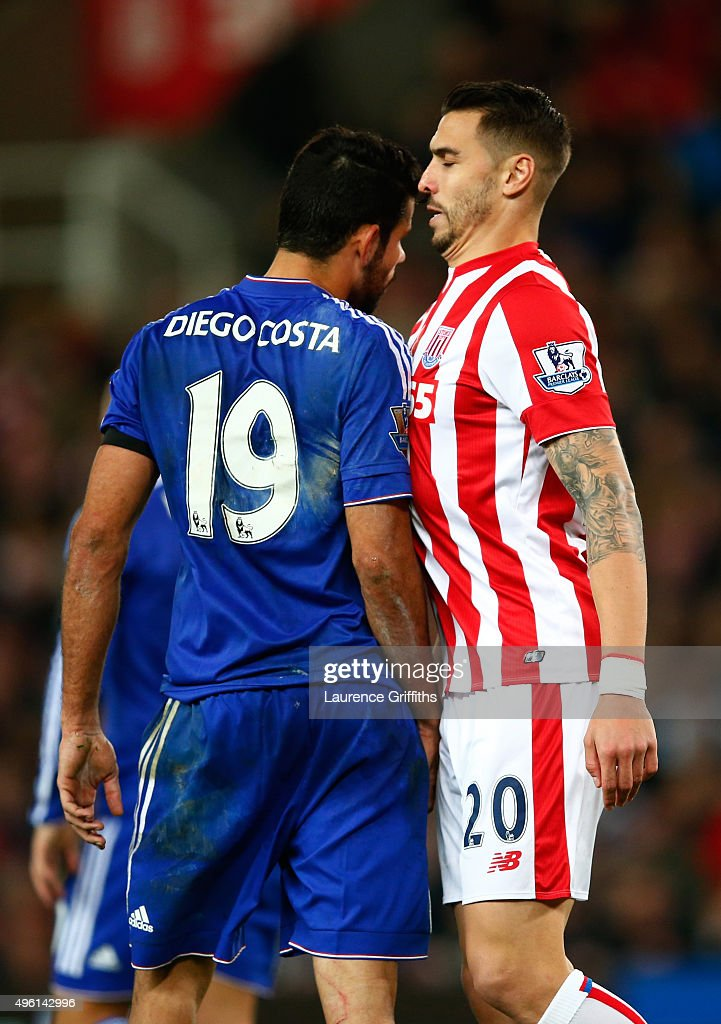 Diego Costa of Chelsea and <a gi-track='captionPersonalityLinkClicked' href=/galleries/search?phrase=Geoff+Cameron&family=editorial&specificpeople=5101639 ng-click='$event.stopPropagation()'>Geoff Cameron</a> of Stoke City argue during the Barclays Premier League match between Stoke City and Chelsea at Britannia Stadium on November 7, 2015 in Stoke on Trent, England.