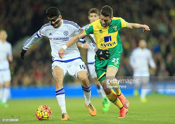 Diego Costa of Chelsea and Ivo Pinto of Norwich City compete for the ball during the Barclays Premier League match between Norwich City and Chelsea...