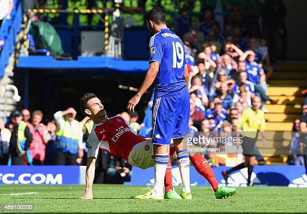 Diego Costa of Chelsea and Laurent Koscielny of Arsenal clash during the Barclays Premier League match between Chelsea and Arsenal at Stamford Bridge...