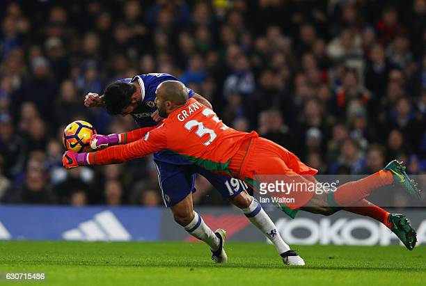 Diego Costa of Chelsea and Lee Grant of Stoke City compete for the ball during the Premier League match between Chelsea and Stoke City at Stamford...
