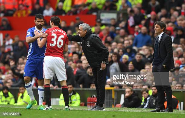 Diego Costa of Chelsea and Matteo Darmian of Manchester United confront each other during the Premier League match between Manchester United and...