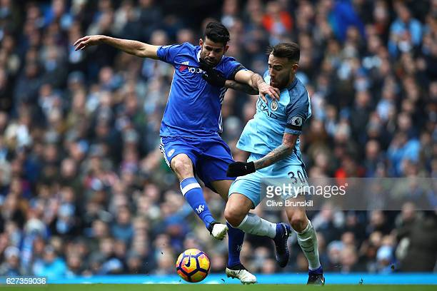 Diego Costa of Chelsea and Nicolas Otamendi of Manchester City compete for the ball during the Premier League match between Manchester City and...