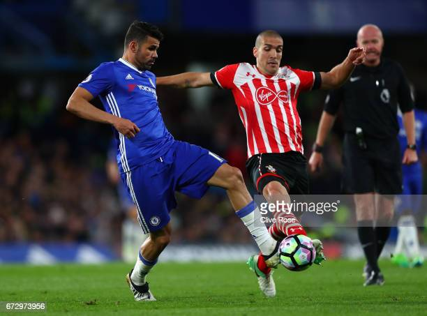 Diego Costa of Chelsea and Oriol Romeu of Southampton battle for the ball during the Premier League match between Chelsea and Southampton at Stamford...