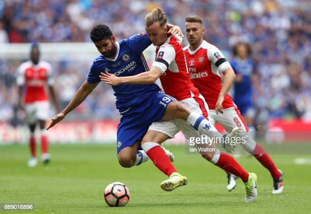 Diego Costa of Chelsea and Rob Holding of Arsenal challenge for the ball during The Emirates FA Cup Final between Arsenal and Chelsea at Wembley...