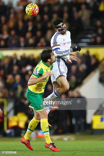 Diego Costa of Chelsea and Russel Martin of Norwich City compete for the ball during the Barclays Premier League match between Norwich City and...