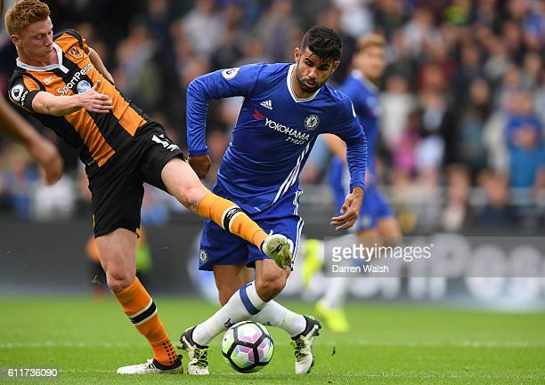 Diego Costa of Chelsea and Sam Clucas of Hull City battle for possession during the Premier League match between Hull City and Chelsea at KCOM...