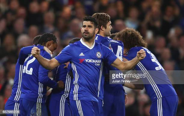 Diego Costa of Chelsea and team mates celebrate as N'Golo Kante of Chelsea scores their first goal during The Emirates FA Cup QuarterFinal match...