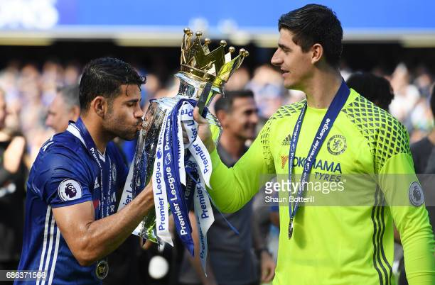 Diego Costa of Chelsea and Thibaut Courtois of Chelsea celebrate with the Premier League Trophy after the Premier League match between Chelsea and...