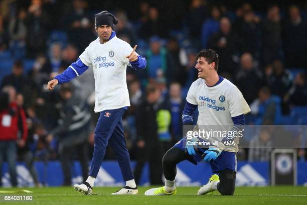 Diego Costa of Chelsea and Thibaut Courtois of Chelsea mess around before the Premier League match between Chelsea and Watford at Stamford Bridge on...