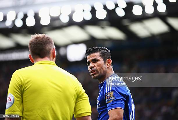 Diego Costa of Chelsea argues with a linesman during the Barclays Premier League match between Chelsea and Crystal Palace at Stamford Bridge on...