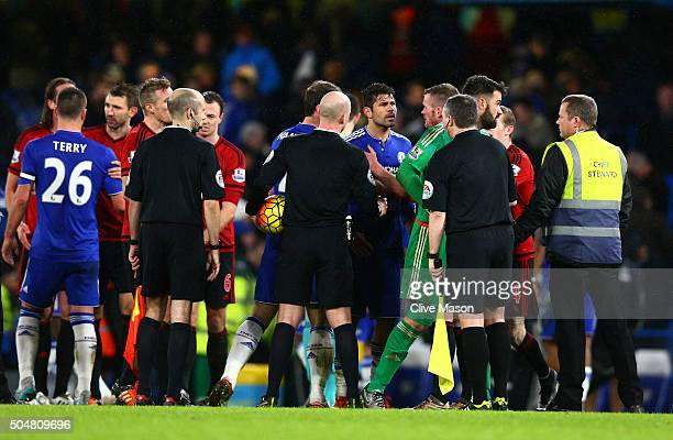 Diego Costa of Chelsea argues with West Bromwich Albion players after the final whistle of the Barclays Premier League match between Chelsea and West...