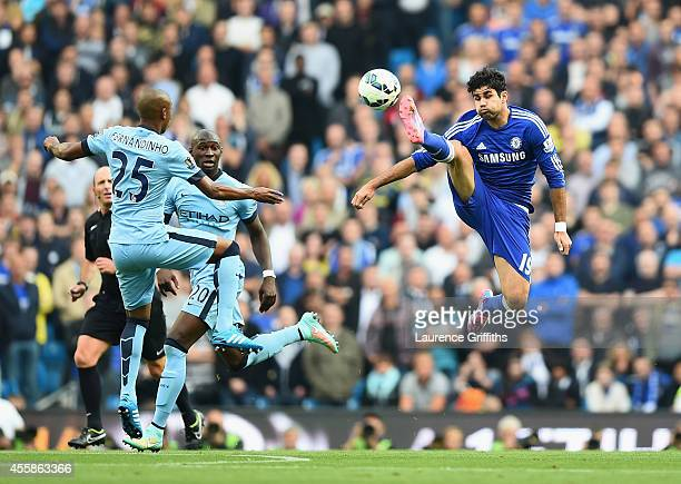 Diego Costa of Chelsea battles for the ball with Fernandinho of Manchester City during the Barclays Premier League match between Manchester City and...