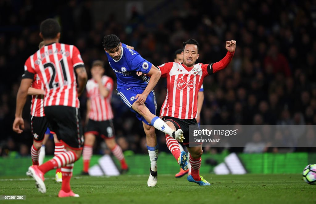 Diego Costa of Chelsea (beats Maya Yoshida of Southampton as he scores their fourth goal during the Premier League match between Chelsea and Southampton at Stamford Bridge on April 25, 2017 in London, England.