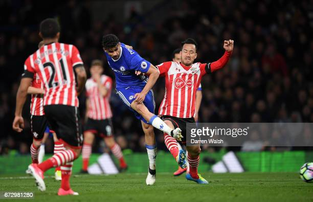 Diego Costa of Chelsea beats Maya Yoshida of Southampton as he scores their fourth goal during the Premier League match between Chelsea and...