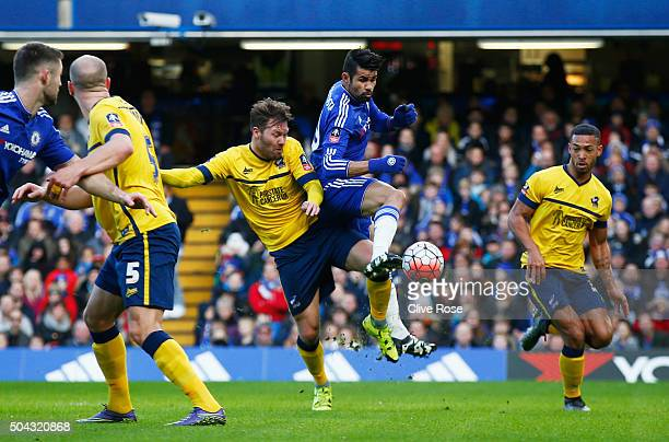 Diego Costa of Chelsea beats Scott Laird of Scunthorpe United to score their first goal during the Emirates FA Cup third round match between Chelsea...