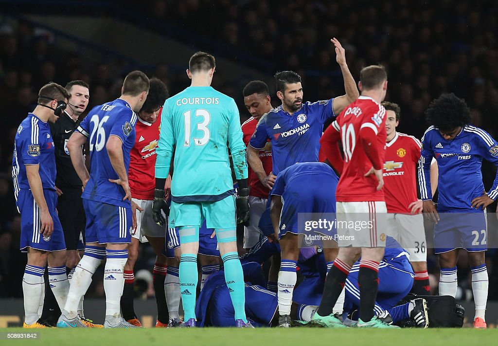 Diego Costa of Chelsea calls for a stretcher as <a gi-track='captionPersonalityLinkClicked' href=/galleries/search?phrase=Kurt+Zouma&family=editorial&specificpeople=7905425 ng-click='$event.stopPropagation()'>Kurt Zouma</a> lies injured during the Barclays Premier League match between Chelsea and Manchester United at Stamford Bridge on February 7 2016 in London, England.