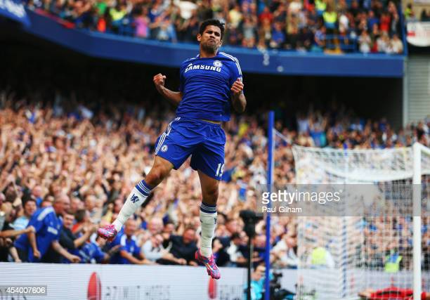 Diego Costa of Chelsea celebrates as he scores their first goal during the Barclays Premier League match between Chelsea and Leicester City at...