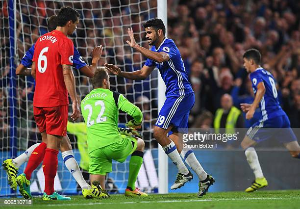 Diego Costa of Chelsea celebrates as he scores their first goal during the Premier League match between Chelsea and Liverpool at Stamford Bridge on...