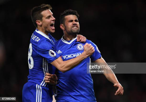 Diego Costa of Chelsea celebrates as he scores their fourth goal with team mate Cesar Azpilicueta during the Premier League match between Chelsea and...