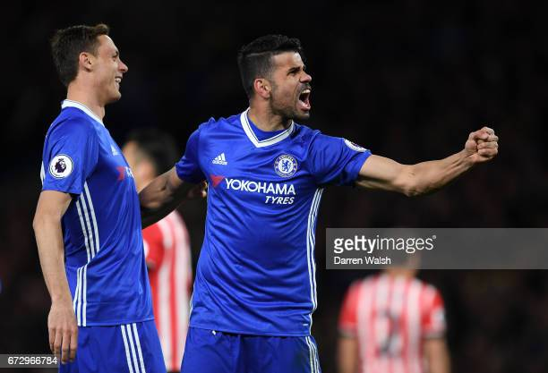 Diego Costa of Chelsea celebrates as he scores their third goal with team mate Nemanja Matic during the Premier League match between Chelsea and...