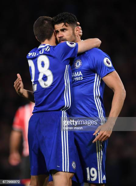 Diego Costa of Chelsea celebrates as he scores their third goal with team mate Cesar Azpilicueta during the Premier League match between Chelsea and...
