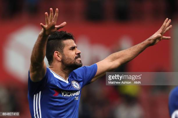 Diego Costa of Chelsea celebrates at the end of the Premier League match between Stoke City and Chelsea at Bet365 Stadium on March 18 2017 in Stoke...