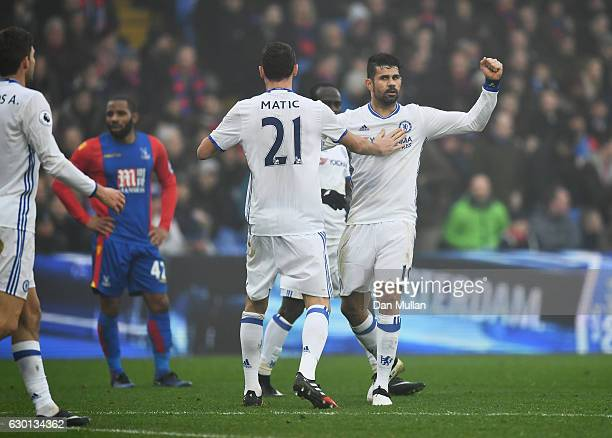 Diego Costa of Chelsea celebrates scoring his sides first goal with Nemanja Matic of Chelsea during the Premier League match between Crystal Palace...