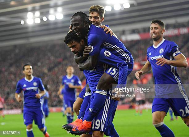 Diego Costa of Chelsea celebrates scoring his sides second goal with Victor Moses of Chelsea and his Chelsea team mates during the Premier League...