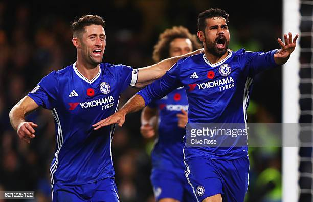 Diego Costa of Chelsea celebrates scoring his sides third goal with Gary Cahill of Chelsea during the Premier League match between Chelsea and...