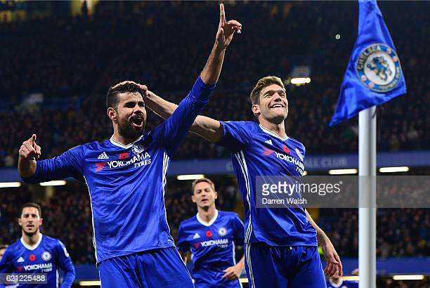 Diego Costa of Chelsea celebrates scoring his sides third goal with Marcos Alonso of Chelsea during the Premier League match between Chelsea and...