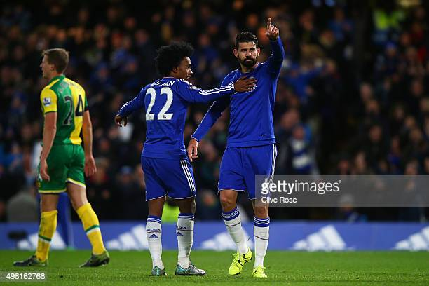 Diego Costa of Chelsea celebrates scoring his team's first goal with his team mate Willian during the Barclays Premier League match between Chelsea...