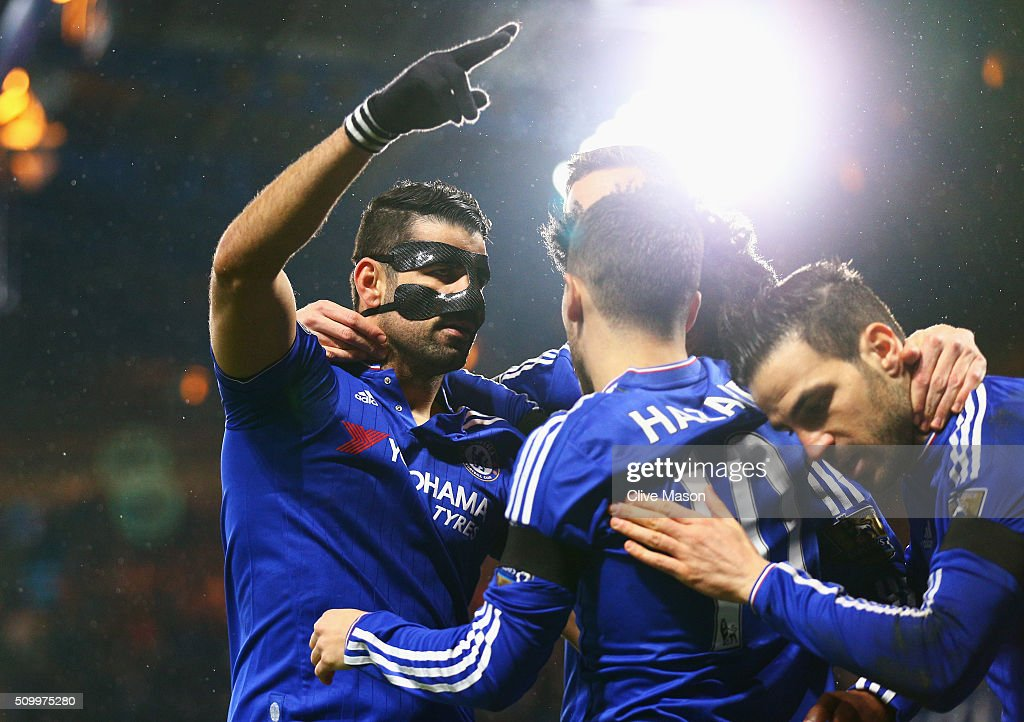 Diego Costa (L) of Chelsea celebrates scoring his team's first goal with his team mates during the Barclays Premier League match between Chelsea and Newcastle United at Stamford Bridge on February 13, 2016 in London, England.