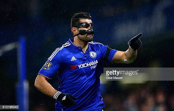 Diego Costa of Chelsea celebrates scoring his team's first goal with his team mates during the Barclays Premier League match between Chelsea and...