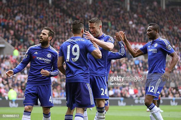 Diego Costa of Chelsea celebrates scoring his team's first goal with his team mates during the Barclays Premier League match between Sunderland and...
