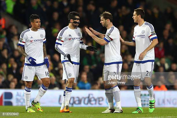 Diego Costa of Chelsea celebrates scoring his team's second goal with his team mates Kenedy Branislav Ivanovic and Nemanja Matic during the Barclays...