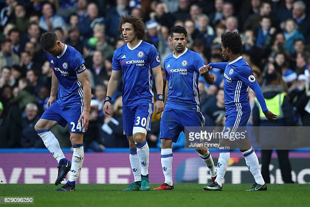 Diego Costa of Chelsea celebrates scoring the opening goal with his team mates Gary Cahill David Luiz and Willian during the Premier League match...