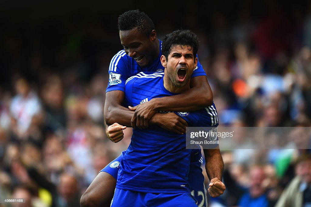 Diego Costa of Chelsea celebrates scoring their second goal with John Obi Mikel of Chelsea during the Barclays Premier League match between Chelsea and Arsenal at Stamford Bridge on October 4, 2014 in London, England.