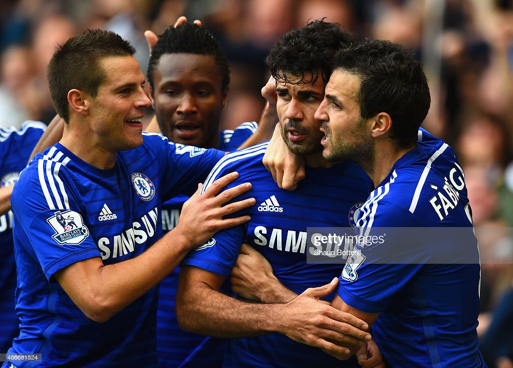 Diego Costa of Chelsea celebrates scoring their second goal with Cesar Azpilicueta and Cesc Fabregas of Chelsea during the Barclays Premier League match between Chelsea and Arsenal at Stamford Bridge on October 4, 2014 in London, England.