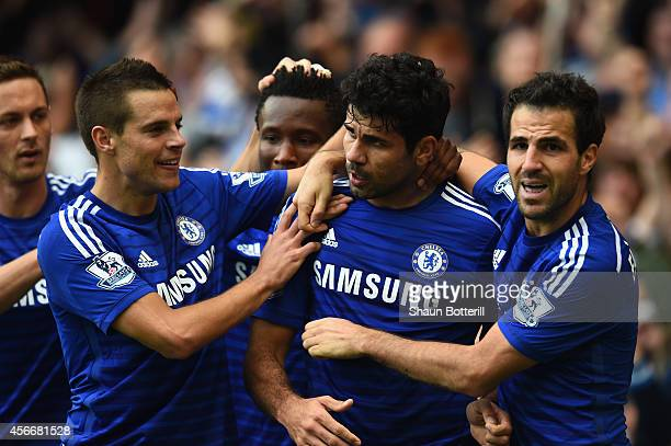 Diego Costa of Chelsea celebrates scoring their second goal with Cesar Azpilicueta and Cesc Fabregas of Chelsea during the Barclays Premier League...