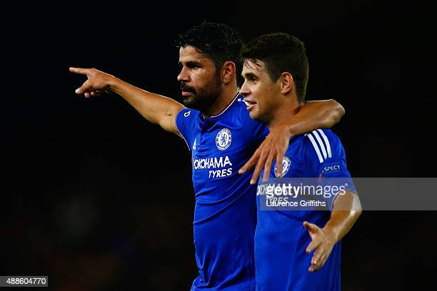 Diego Costa of Chelsea celebrates scoring their third goal with Oscar of Chelsea during the UEFA Chanmpions League group G match between Chelsea and...