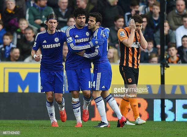 Diego Costa of Chelsea celebrates with Filipe Luis and Cesc Fabregas as he scores their second goal during the Barclays Premier League match between...