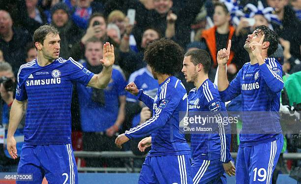 Diego Costa of Chelsea celebrates with team mates after his shot on goal is deflected in for a second by Kyle Walker of Spurs during the Capital One...