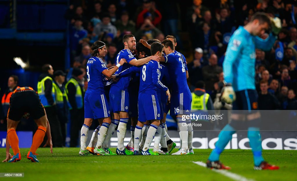 Diego Costa of Chelsea (C) celebrates with team mates as he scores their second goal during the Barclays Premier League match between Chelsea and Hull City at Stamford Bridge on December 13, 2014 in London, England.